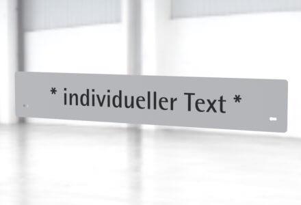 Beschriftungsset mit Ihrem individuellen Text zur Montage am Gestell der apra-lean Produkte
